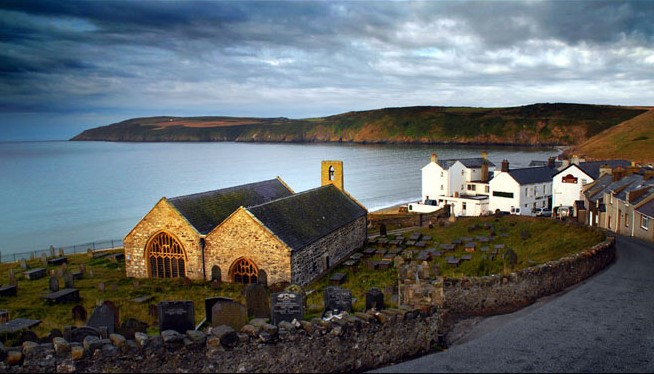 St. Hywyn's Church and the village of Aberdaron Wales, site of the RS Thomas & ME Eldridge Poetry & Art Festival